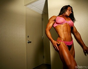 Female bodybuilder Andrea G is featured in all of her glory, her biceps, her legs. She's  featured topless and bottomless, meaning she's completely nude and we get to take in all of her amazing physique. We are so lucky!
