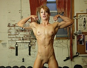 Muscular redhead Charlotte has a small frame, but every inch of it is packed with muscle. Powerful biceps, ripped abs, long strong legs, and a muscular back - Charlotte really does have an amazing physique. Of course, once she's sweating Charlotte decides to take of all of her clothes to show us just how amazing her body is. Fantastic!