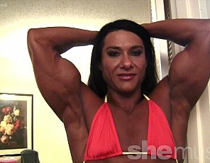 Alina Popa is wearing the tiniest of bikinis - just enough to leave a little to the imagination. What isn't left to the imagination is pretty damned impressive. Big biceps, powerful quads and ripped abs. Alina also gives us her famous muscle control pec bounces and glute flexing.