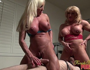 Female bodybuilders and  fem dommes Ashlee Chambers and Wild Kat behave like the muscle porn stars they are as they pose and use the ripped muscles of their vascular biceps, pecs, legs, glutes and abs to give their slave a lift and carry blow job, while he worships their muscles and you watch in close-up.