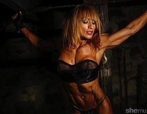 In the dungeon, female bodybuilder Karina's posing for you in tiny panties, showing you how hot her vascular biceps, ripped abs and muscular legs and glutes are. The closer up you get, the better she looks.