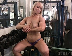 Female bodybuilder Genie poses in the gym for you, showing off the big muscles of her biceps, glutes and legs, and letting you look in close-up for as long as you want as she gets into masturbation. We like it too, don't we?