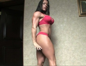 Ripped female bodybuilder Bella is posing, showing off her big, vascular biceps, her powerful pecs, her strong legs and glutes and her awesome abs. You wanna touch me? she asks, taking off her panties so he can see her ass and worship her muscles. She gives him a blow job, then lets him penetrate her wet pussy with his fingers and cock while she masturbates her big clit. You get to watch the muscle sex in close-up.
