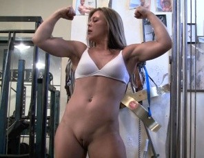 Breanna pulls off her panties in the gym and, nude, shows you just how flexible she is. First she flexes her biceps, then puts her head right through her legs and gives you a close-up look at her pretty kitty and glutes from behind, then spreads her legs for a front view, and then puts one leg up, leaning sideways to give you a look at her tight abs – and pussy - that you won't believe. And that's no stretch.